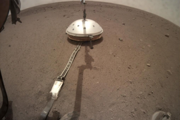 NASA___s_InSight_lander_has_its_seismic_instrument_tucked_under_a_shield_to_protect_it_from_wind_and_extreme_temperatures.__