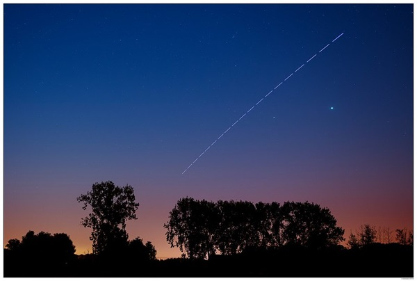 The International Space Station leaves a trail in the sky
