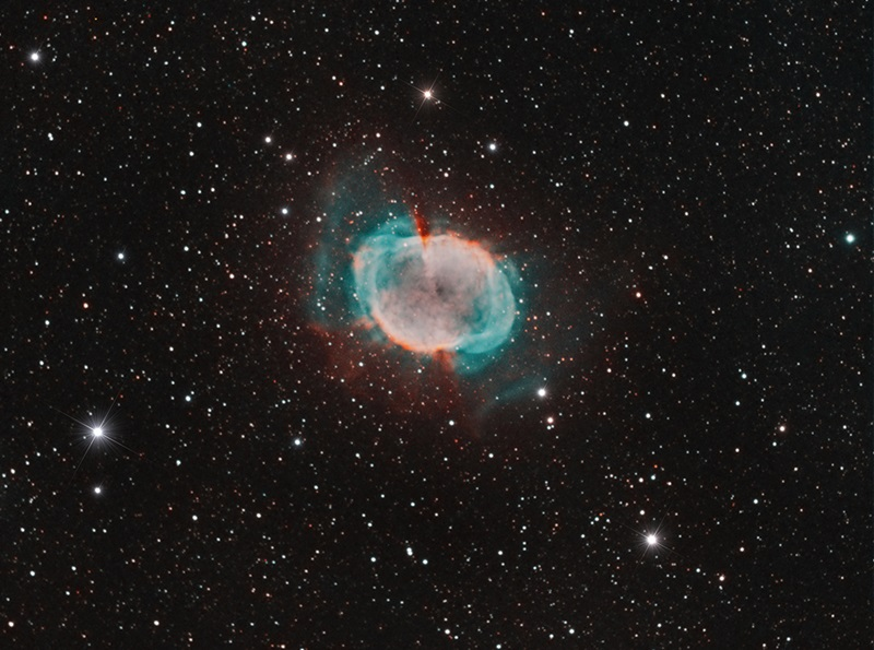Daniel Beaulieu from Quebec, Canada The Dumbbell Nebula, also known as Messier 27, is a planetary nebula in the constellation Vulpecula the Fox. It lies 1,230 light-years away and carries the distinction of being the first planetary nebula to be discovered. Charles Messier found it in 1764.