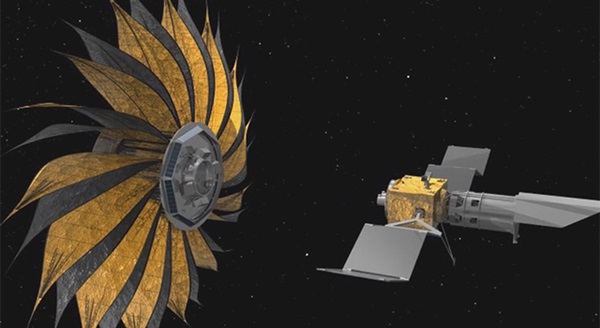 This image shows the prototype starshade, a giant structure designed to block the glare of stars so that future space telescopes can take pictures of planets.