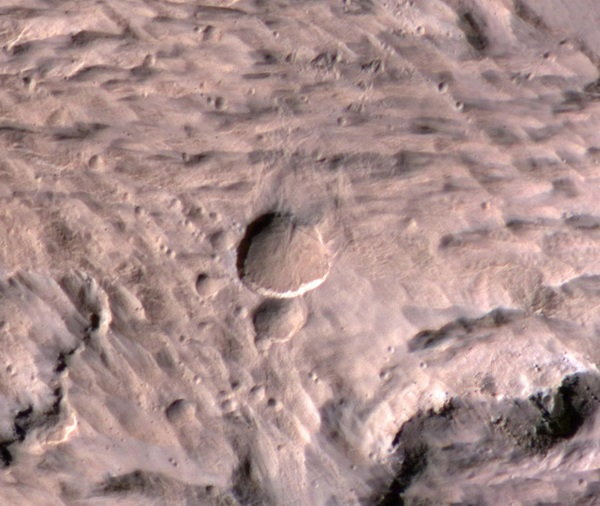 A new Mars crater spans half the length of a football field.