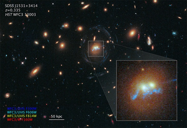 "A ""string of pearls"" are superclusters of blazing blue-white newly born stars."