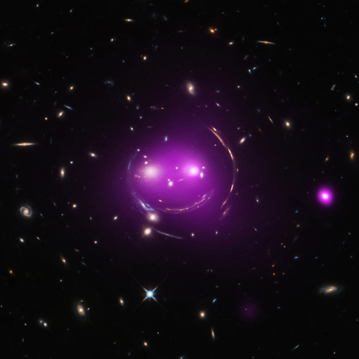 "This group of galaxies has been nicknamed the ""Cheshire Cat"" because of its resemblance to a smiling feline."