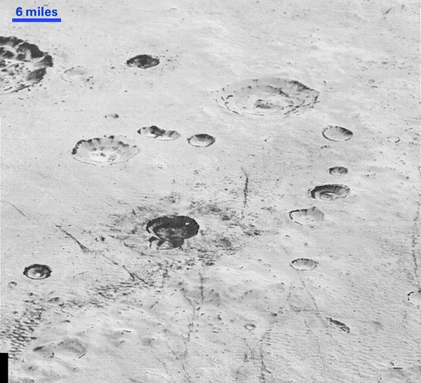 Pluto's rugged, icy cratered plains include layering in the interior walls of many craters.