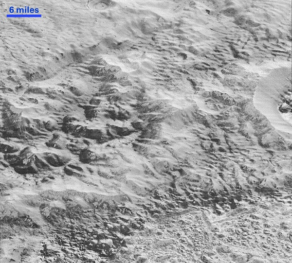 Erosion and faulting has sculpted portions of Pluto's icy crust into rugged badlands.