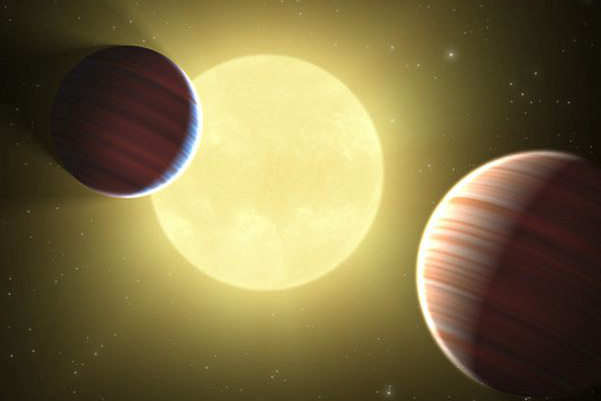 Artist rendition of the Kepler-9 planetary system, showing the two Saturn-mass planets b and c.