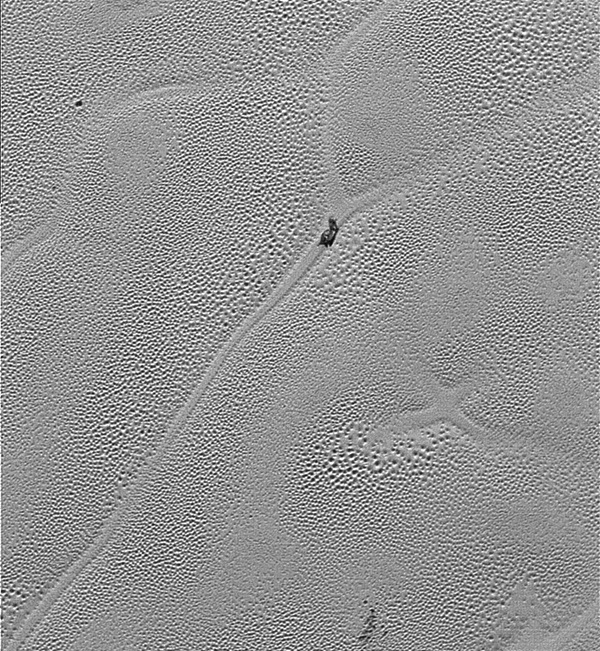 This image from the Long Range Reconnaissance Imager extends New Horizons' highest-resolution swath of Pluto to the very center of Sputnik Planum.