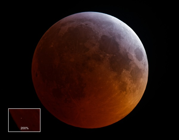 Impact on the Moon during the total lunar eclipse