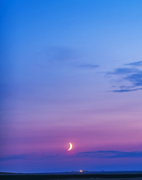 A waxing crescent Moon anchored the early evening sky August 21, 2012.