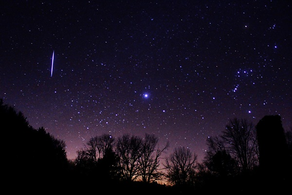 A Leonid meteor blazes across the November sky east of Orion and Sirius in this view from the peak of the 2012 shower.