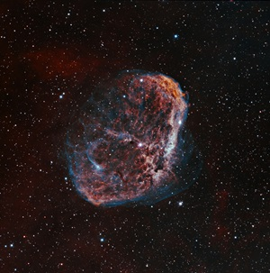 The Crescent Nebula (NG 6888) is an emission nebula in the constellation Cygnus the Swan.