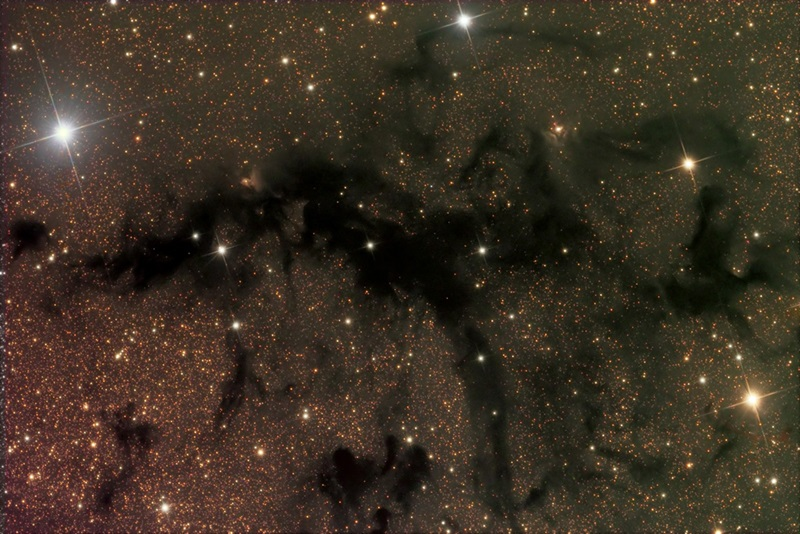 The dark nebula LDN 673 lies in the constellation Aquila the Eagle near that star pattern's brightest luminary, Altair (Alpha Aquilae).