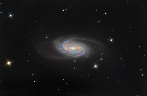 NGC 2903 is a barred spiral galaxy in the constellation Leo the Lion.