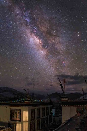 The center bugle of the Milky Way shines brightly above Zhaxizong, a Tibetan village in China.