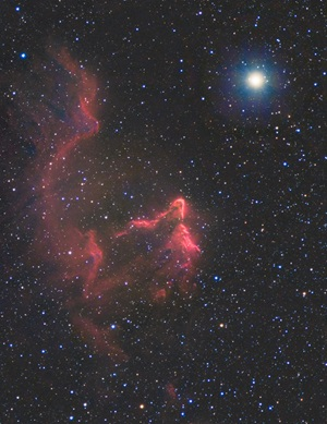 The Ghost of Cassiopeia (IC 63) is an emission nebula near the star Navi (Gamma Cassiopeiae).