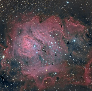 NGC 6530 is a young open cluster with surrounding nebulosity that lies near the Lagoon Nebula (M8) in the constellation Sagittarius the Archer.