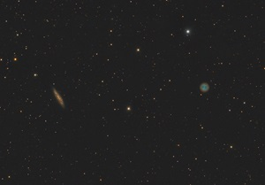 The Surfboard Galaxy (M108, left) and the Owl Nebula (M97) float through space in the constellation Ursa Major the Great Bear.