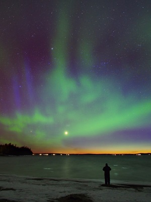 The planet's light competed with a bright aurora and the last rays from the setting Sun.