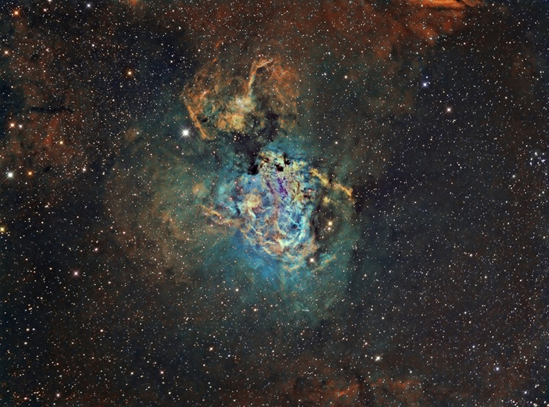 The Swan Nebula through Hubble palette filters
