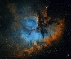 The Pacman Nebula in the Hubble palette