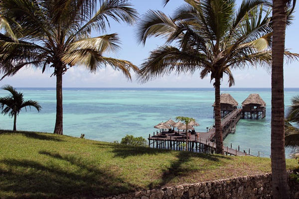 The warm tranquil waters of the Indian Ocean lap at the sandy beaches that surround Zanzibar.