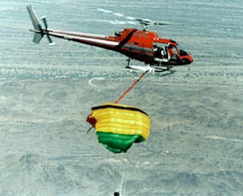Helicoptor practices capture of Genesis return capsule