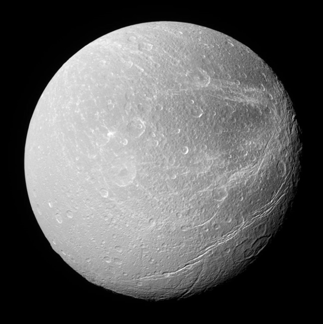 A southerly view of Dione shows enormous canyons extending from mid-latitudes on the trailing hemisphere, at right, to the moon's south polar region. The image was taken in visible light with the Cassini spacecraft narrow-angle camera February 8, 2008. Credit: NASA/JPL/Space Science Institute